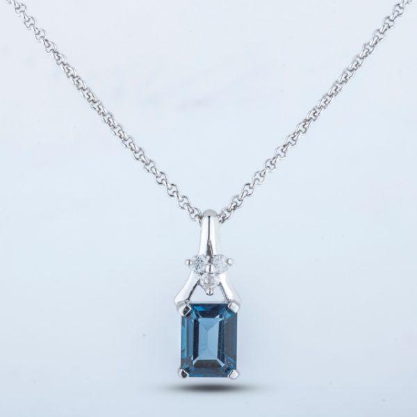 silver blue topaz and diamond pendant