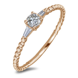Diamond three stone ring in yellow gold