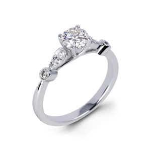 Canadian Round Diamond Side Stone Engagement Ring